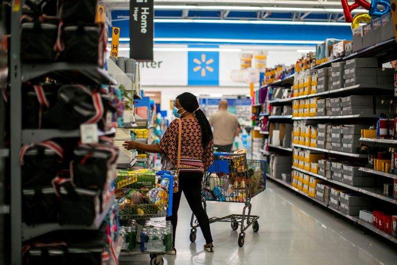 © Reuters. FILE PHOTO: A shopper is seen wearing a mask while shopping at a Walmart store, in North Brunswick, New Jersey