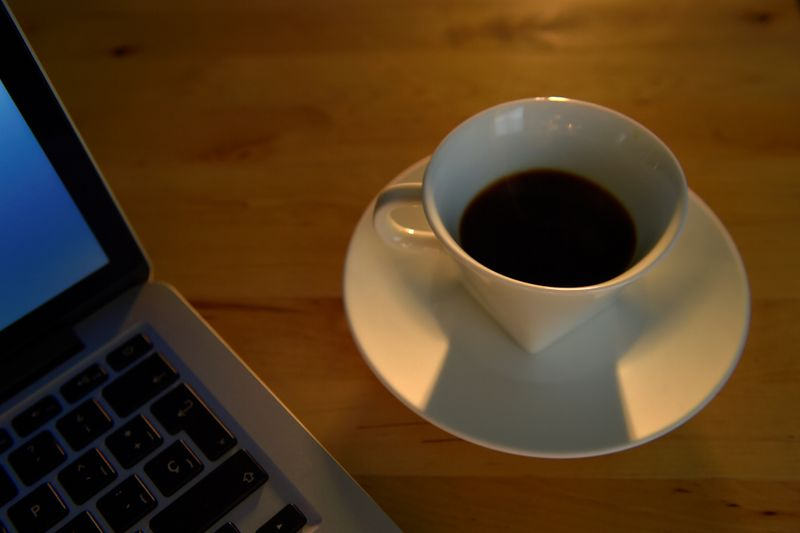 © Reuters. FILE PHOTO: An illustration picture shows a coffee cup near a laptop
