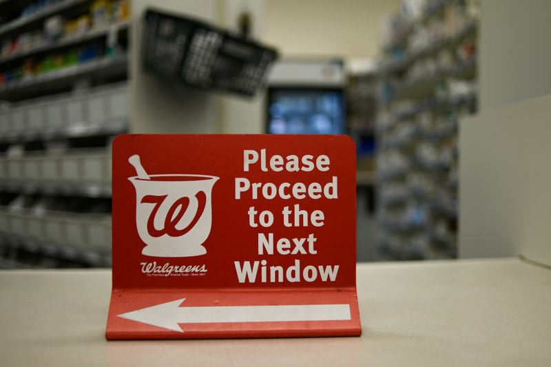 © Reuters. A sign rests on a counter at a Walgreens pharmacy store in Austin, Texas