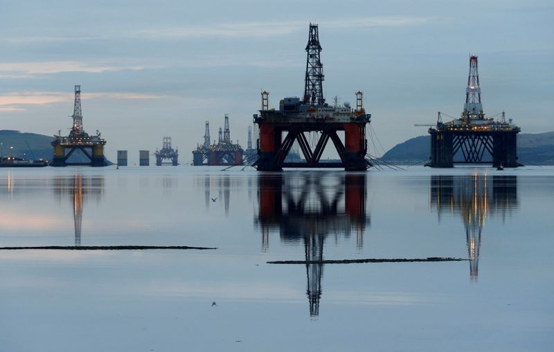 © Reuters. FILE PHOTO: Drilling rigs are parked up in the Cromarty Firth near Invergordon, Scotland