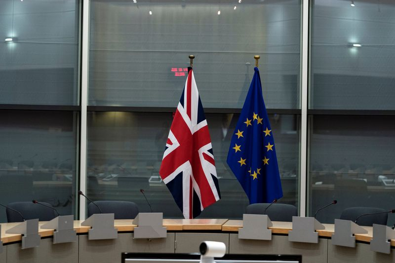 © Reuters. FILE PHOTO: British Union Jack and EU flags are pictured before the meeting with Britain's Brexit Secretary Barclay and EU's chief Brexit negotiator Barnier in Brussels