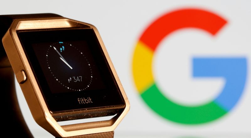 © Reuters. FILE PHOTO: Fitbit Blaze watch is seen in front of a displayed Google logo in this illustration