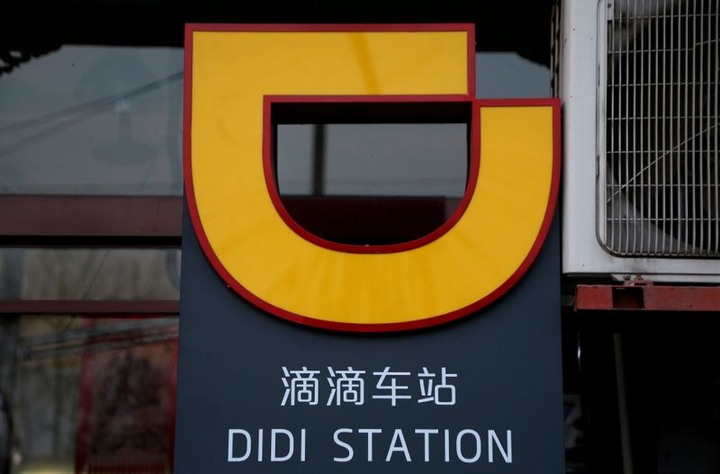 © Reuters. FILE PHOTO: The logo of Didi Chuxing is seen at a Didi station in Beijing