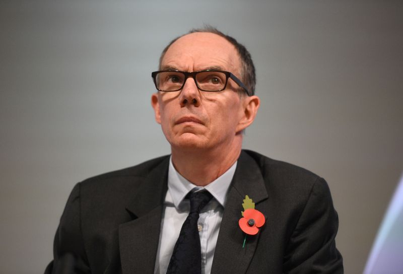 © Reuters. FILE PHOTO: Bank of England Deputy Governor for Markets and Banking, Dave Ramsden attends a Bank of England news conference, in the City of London