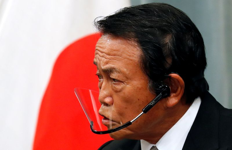 © Reuters. FILE PHOTO:  Japan's newly-appointed Finance Minister Taro Aso speaks at a news conference in Tokyo