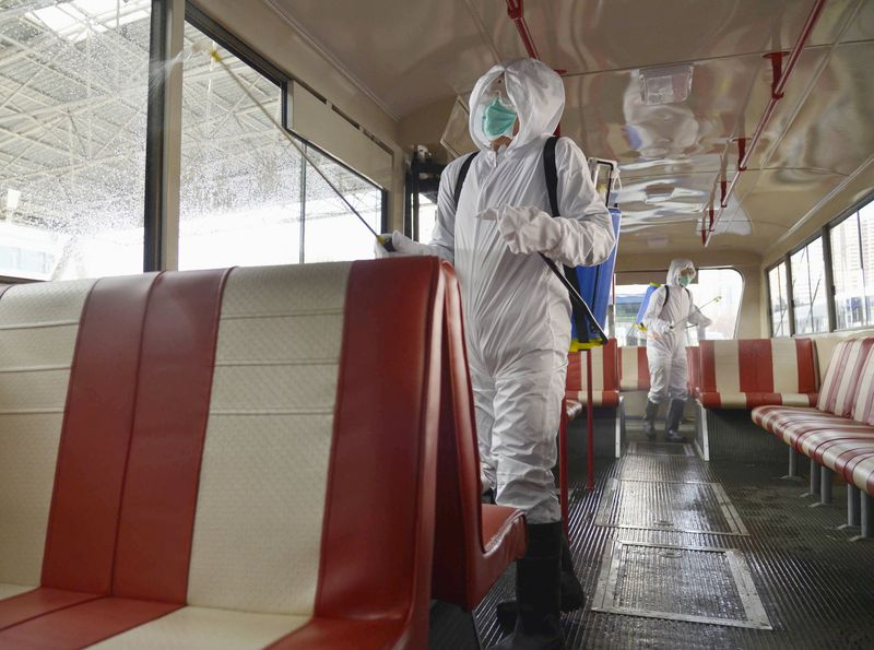 © Reuters. A trolley bus is disinfected amid fears over the spread of the novel coronavirus in Pyongyang