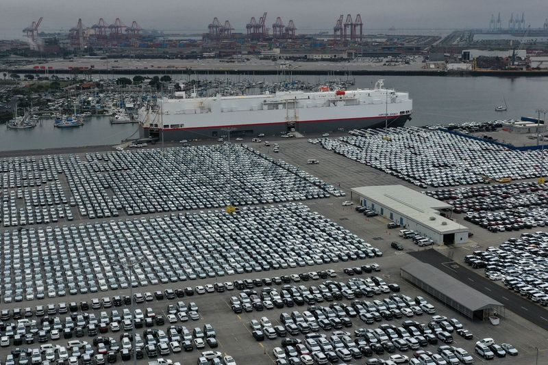 © Reuters. FILE PHOTO: New cars are seen lined up next to the dock as the global outbreak of the coronavirus disease (COVID-19) continues, at the Port of Los Angeles