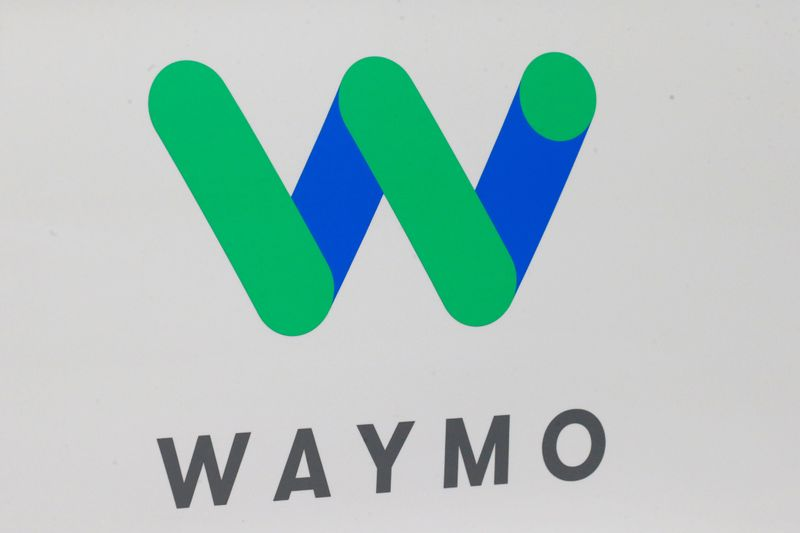 © Reuters. FILE PHOTO: The Waymo logo is displayed during the North American International Auto Show in Detroit