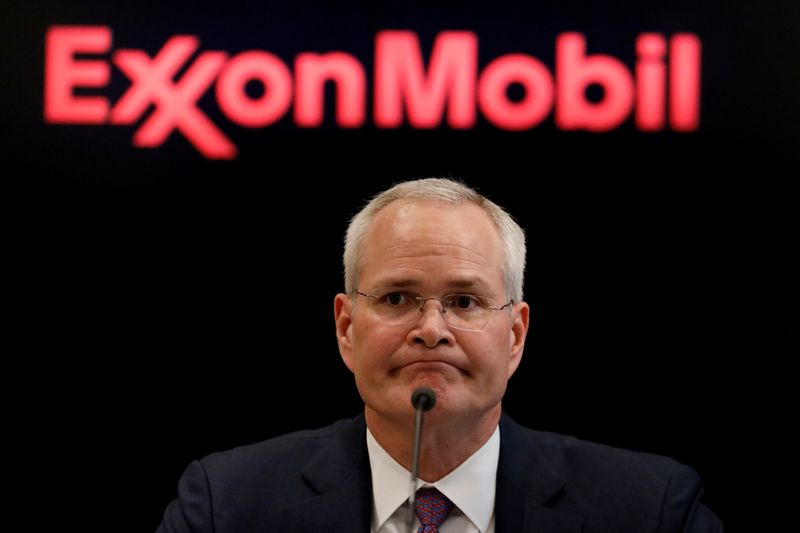 © Reuters. FILE PHOTO: Darren Woods, Chairman & CEO of Exxon Mobil Corporation speaks during a news conference at the NYSE