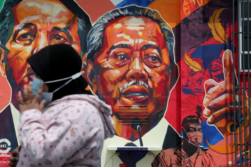 Managing virus crisis, Malaysia's PM needs rivals to back budget