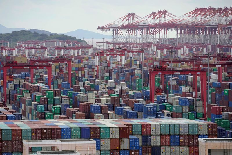 © Reuters. FILE PHOTO: Containers are seen at the Yangshan Deep-Water Port in Shanghai