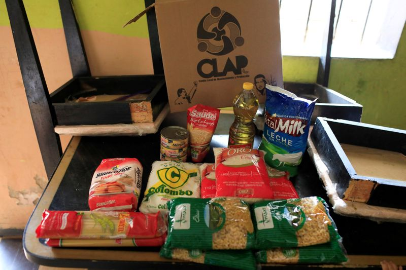 © Reuters. FILE PHOTO: The contents of a CLAP box is pictured at Viviana Colmenares' house in Caracas