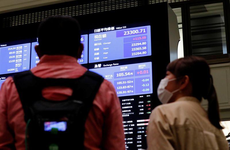 © Reuters. A TOKYO, L'INDICE NIKKEI FINIT EN HAUSSE