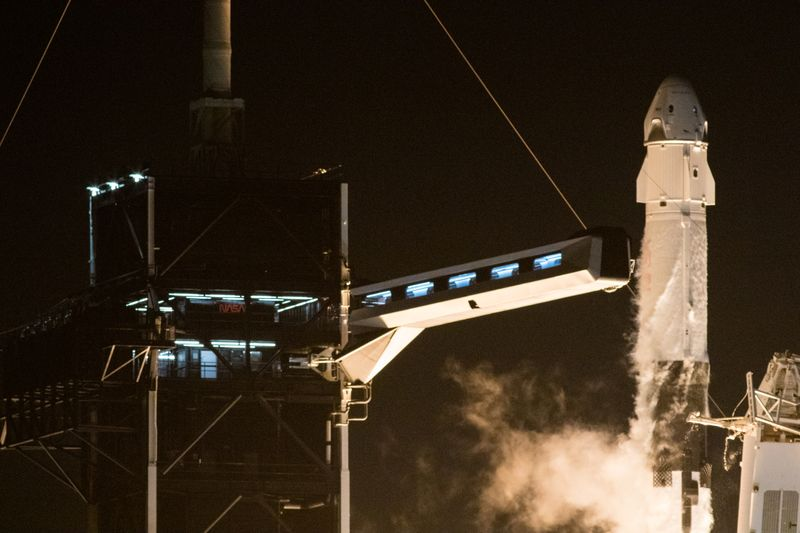 SpaceX capsule, carrying four astronauts, docks with International Space Station