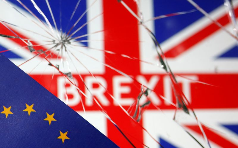 © Reuters. EU flag are placed on broken glass and British flag in this illustration picture taken