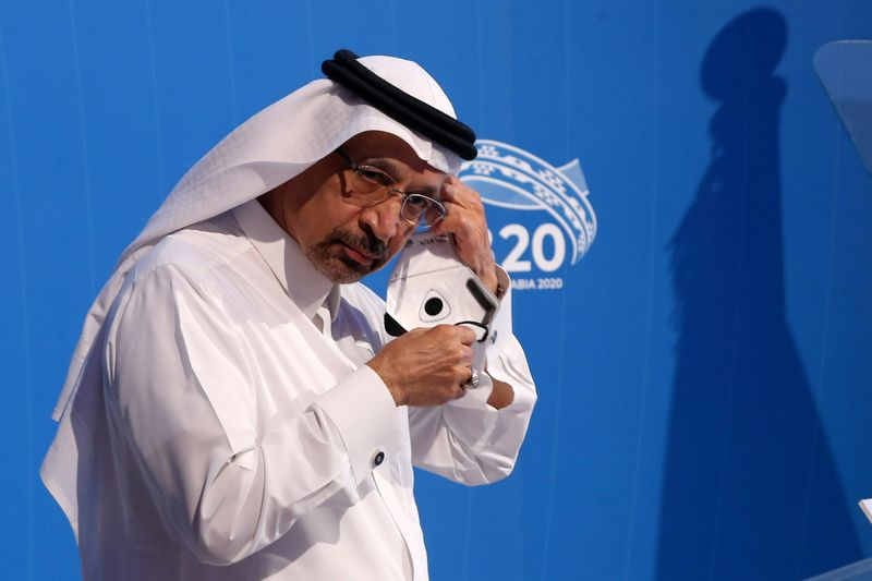 © Reuters. FILE PHOTO: Saudi Arabian Investment Minister Khalid al-Falih, adjusts a mask as he attends a virtual meeting of B20 at the Saudi Business Group summit in Riyadh
