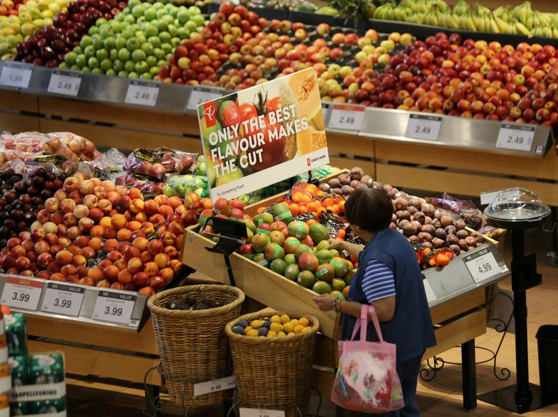 © Reuters. FILE PHOTO: A woman browses in the fruit section of a Loblaw supermarket in Collingwood