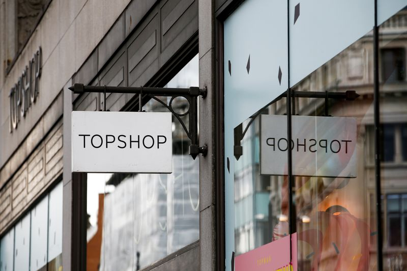 © Reuters. FILE PHOTO: Signage can be seen outside a Topshop and Topman store, owned by Arcadia Group, in central London