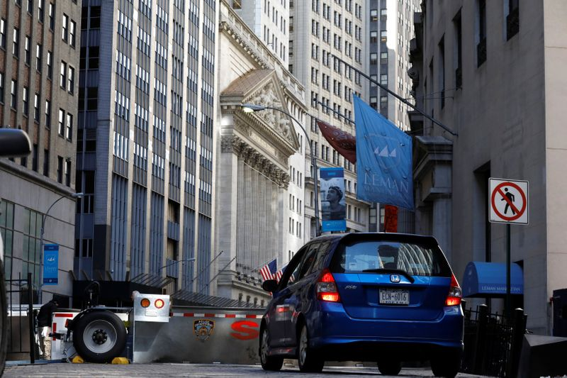 © Reuters. FILE PHOTO: A car waits to enter the financial district security zone near the New York Stock Exchange (NYSE) in New York City