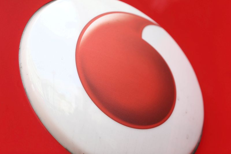 © Reuters. FILE PHOTO: A branded sign is displayed on a Vodafone store in London