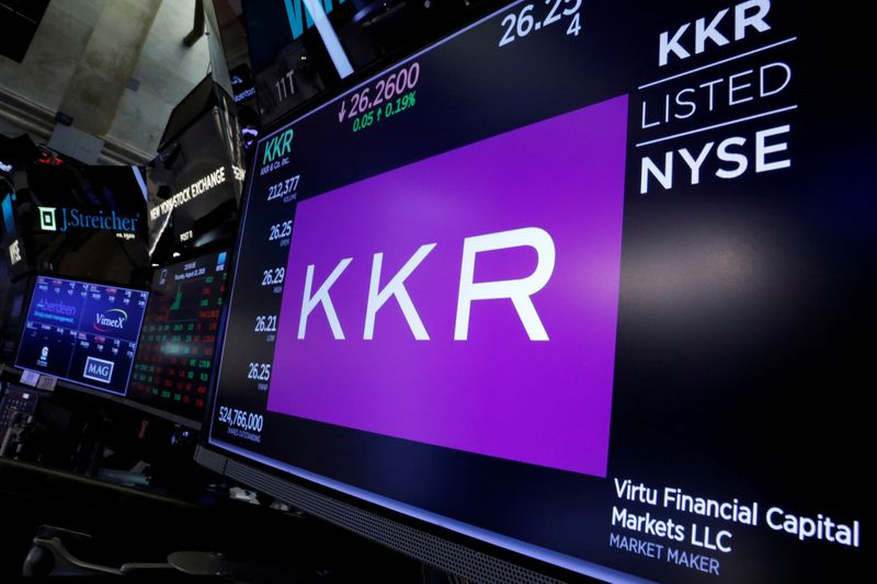 © Reuters. FILE PHOTO: Trading information for KKR & Co is displayed on a screen on the floor of the NYSE in New York