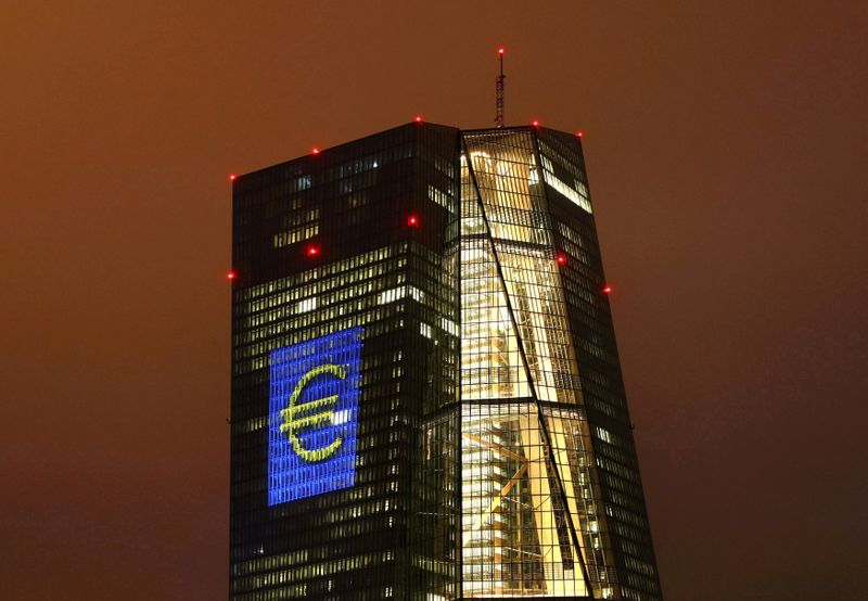 © Reuters. FILE PHOTO: Headquarters of the European Central Bank (ECB) are illuminated with a giant euro sign at the start of the