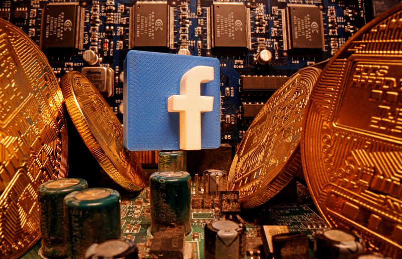 © Reuters. A 3D-printed Facebook logo and representations of cryptocurrency are standing on a motherboard in this picture illustration