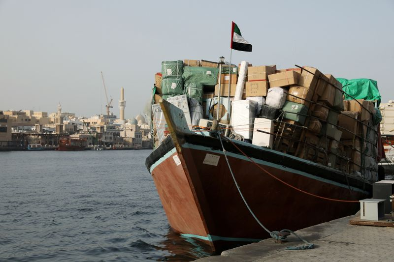 © Reuters. FILE PHOTO: A dhow loaded with goods bound for Iran is seen along the creek in old Dubai