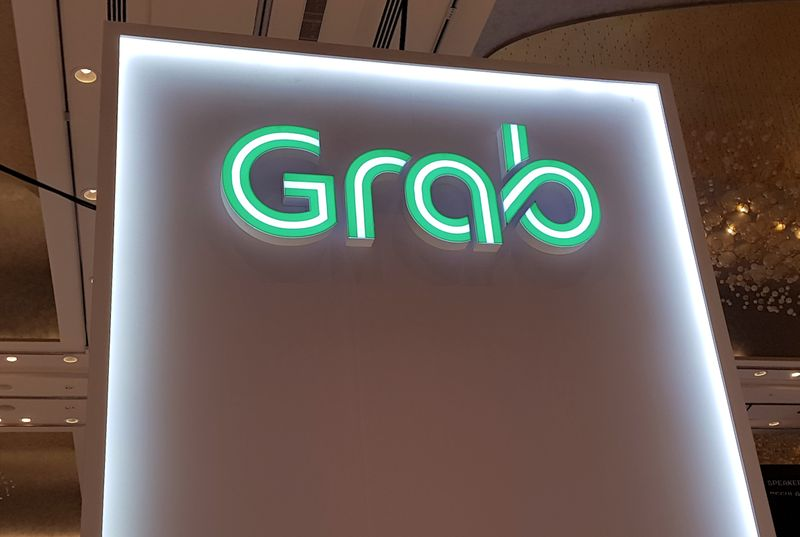 © Reuters. A Grab logo is pictured at the Money 20/20 Asia Fintech Trade Show in Singapore