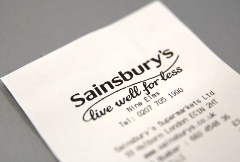 © Reuters. FILE PHOTO: A discarded till receipt lies on a table at a Sainsbury's store in London
