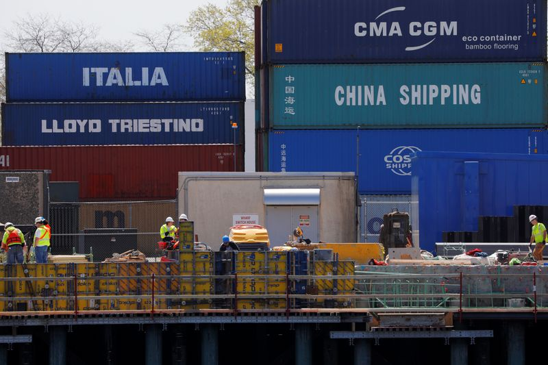 © Reuters. FILE PHOTO: Shipping containers are stacked at the Paul W. Conley Container Terminal in Boston