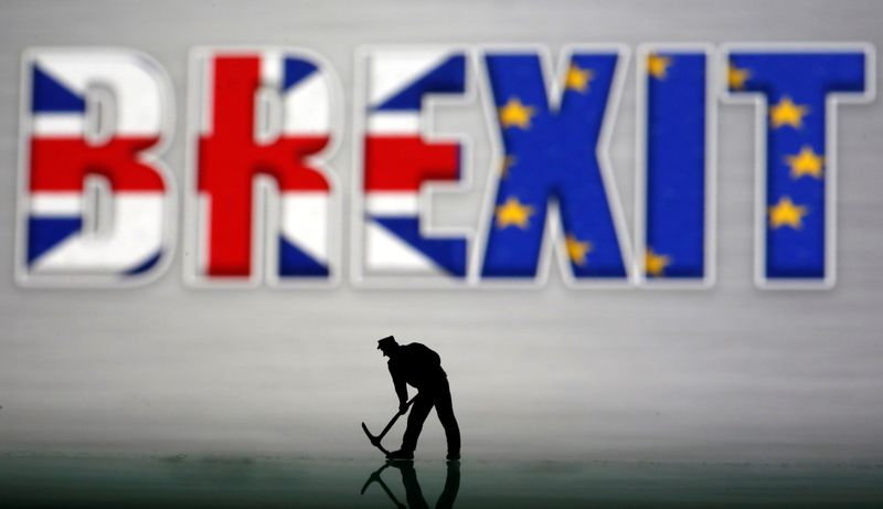 © Reuters. A small toy figure is seen in front of a Brexit logo in this illustration picture