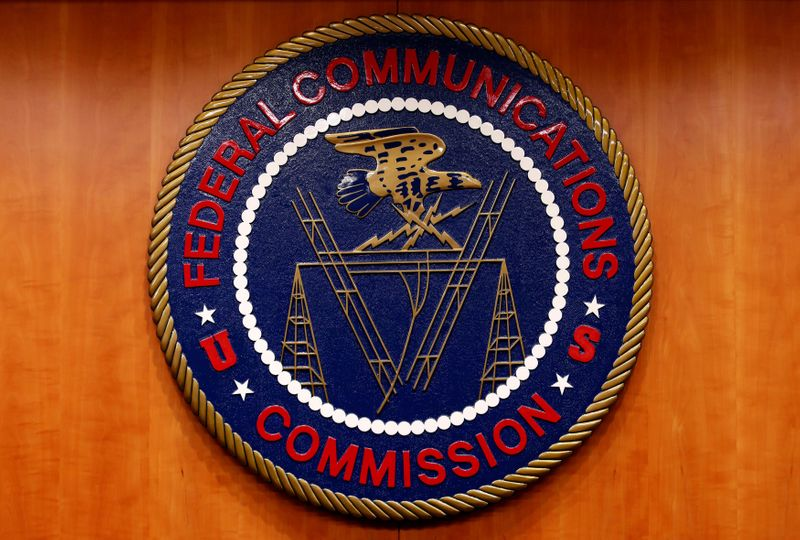 © Reuters. FILE PHOTO: The Federal Communications Commission (FCC) logo is seen before the FCC Net Neutrality hearing in Washington