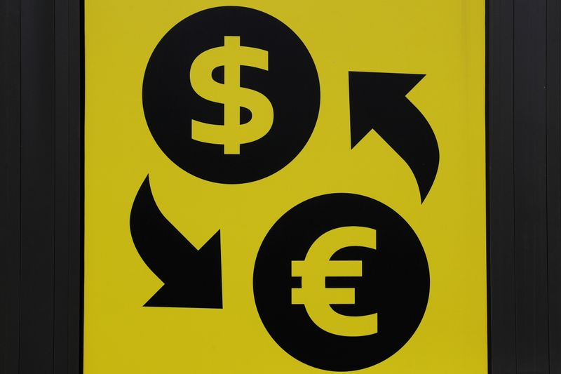 © Reuters. FILE PHOTO: Currency signs of the U.S. dollar and Euro are seen at a currency exchange office in Kiev