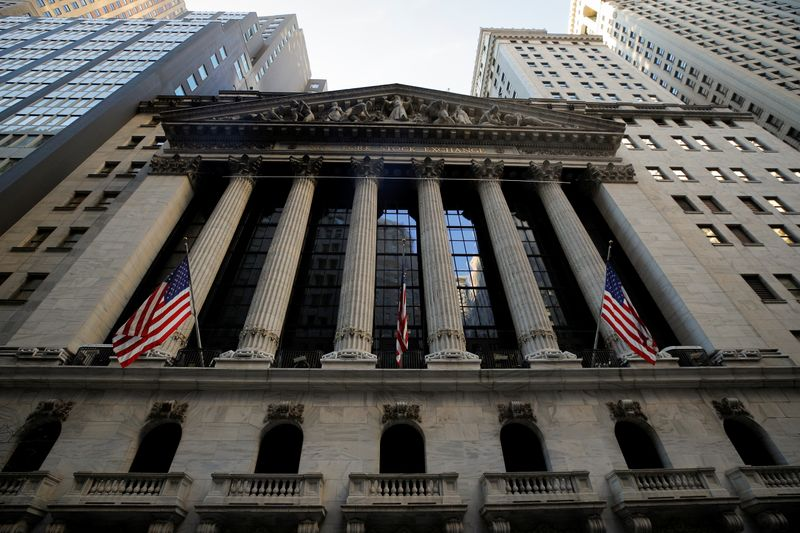 Wall Street ends lower on stimulus uncertainty, Facebook weighs