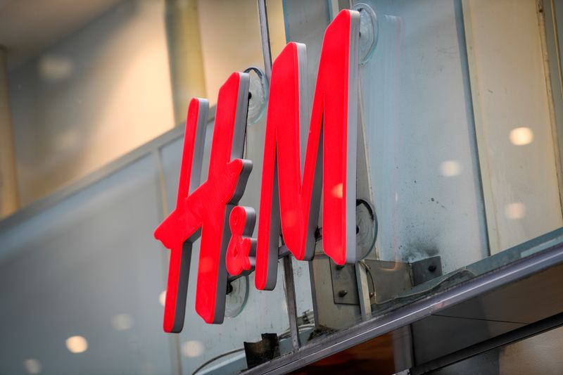 © Reuters. FILE PHOTO: An H&M logotype is seen at a shop in Stockholm