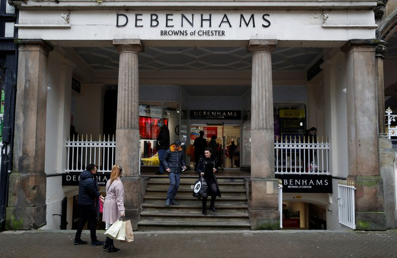 © Reuters. Shoppers walk out of a Debenhams store in Chester, Britain
