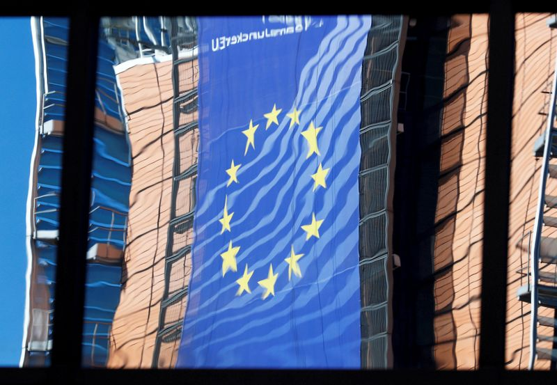 © Reuters. FILE PHOTO: The facade of the EU Commission headquarters is reflected in the windows of the EU Council building in Brussels