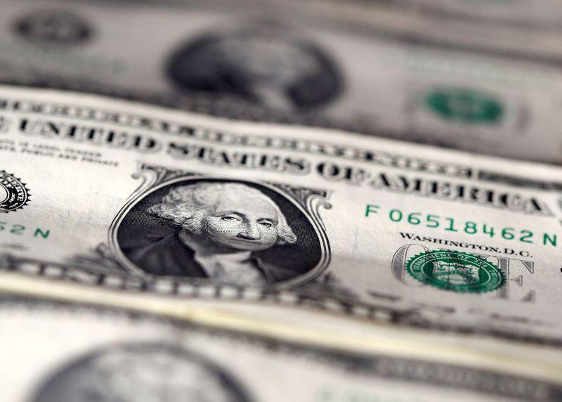 Dollar heavy amid stimulus progress, pound buoyed by Brexit hopes