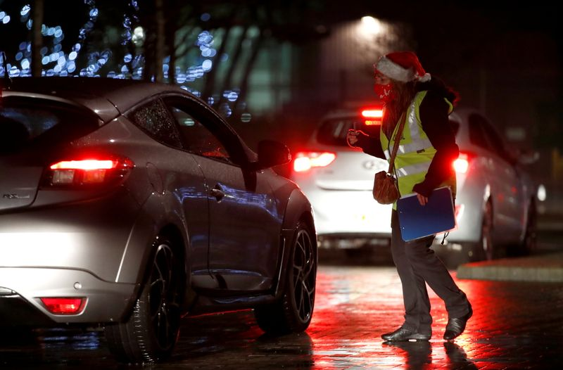 © Reuters. Drive-in carol service in Milton Keynes