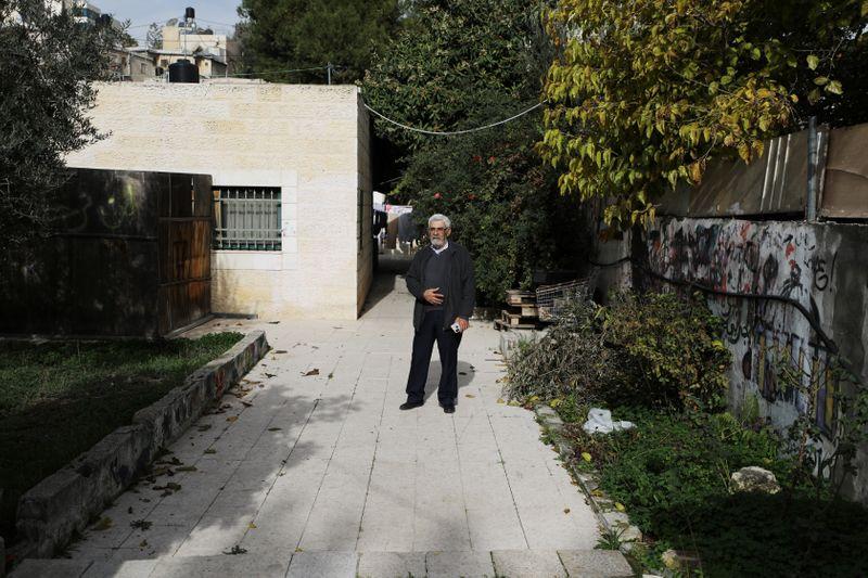 © Reuters. Palestinian Nabil Al-Kurd stands outside his home in east Jerusalem