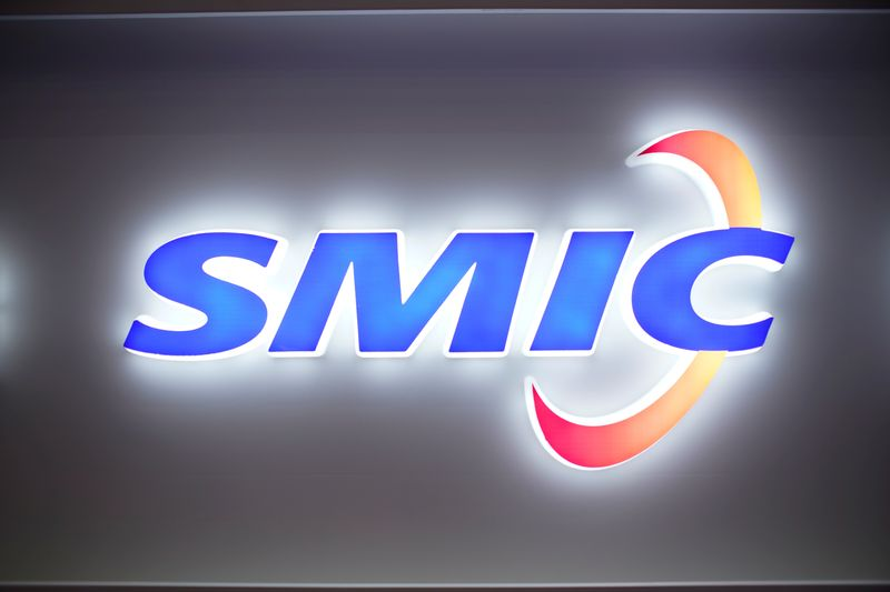 © Reuters. FILE PHOTO: A logo of Semiconductor Manufacturing International Corporation (SMIC) is seen at China International Semiconductor Expo (IC China 2020) in Shanghai, China October 14, 2020.