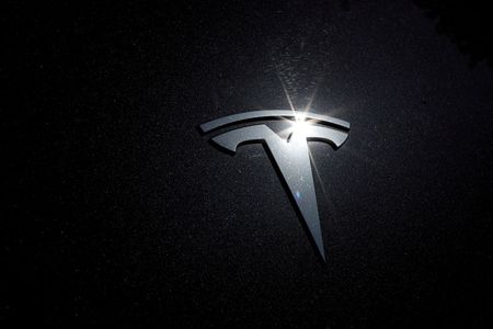 Tesla shares rise in busy trade ahead of S&P 500 debut By Reuters