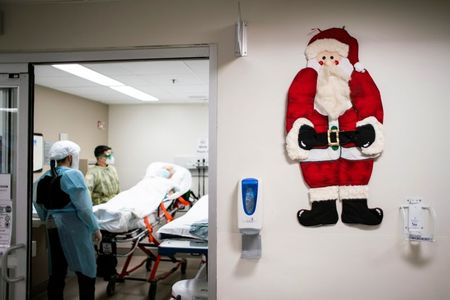 Christmas comfort over COVID vaccines collides with new curbs By Reuters