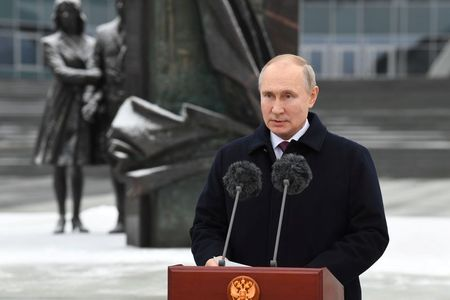 Keep up the good work, Putin tells spy agency staff By Reuters