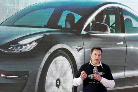 Musk tweets he reached out to Apple's Tim Cook for acquiring Tesla By Reuters