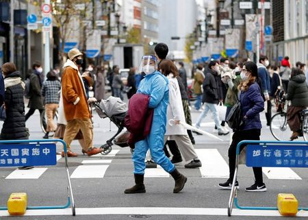 Japan panel says people 65 or older should get COVID vaccine priority By Reuters