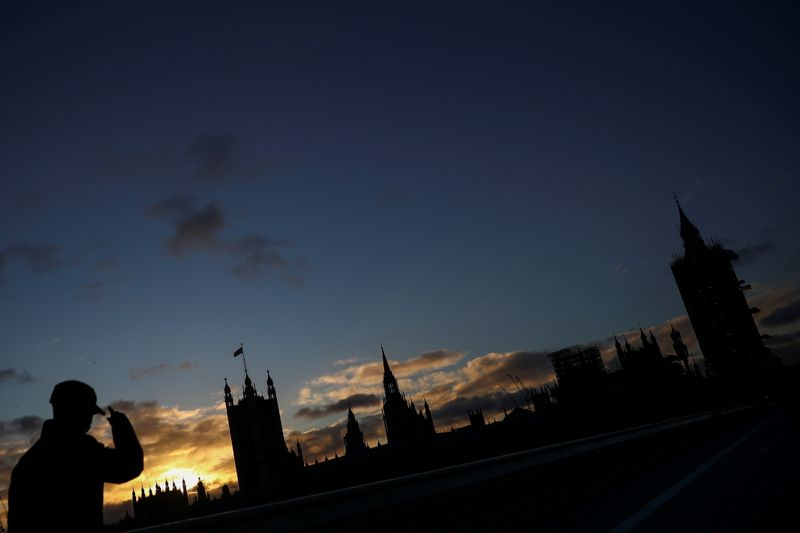 © Reuters. A general view of The Houses of Parliament silhouetted, in London