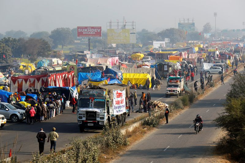 Indian farmers agree to meet government over contentious farm laws By Reuters