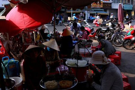 Vietnam's 2020 economic growth slips to 30-year low due to COVID-19 By Reuters